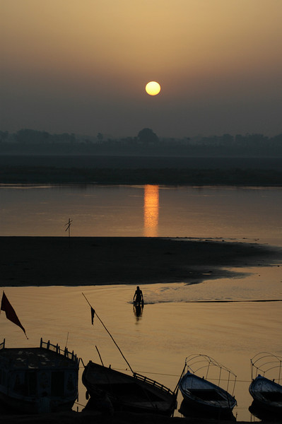 Ganges River, Varanasi India A fisherman bringing in his early morning catch.