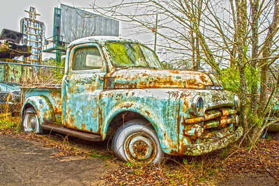 Light blue against rusty orange truck