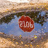 Stop sign reflection in puddle