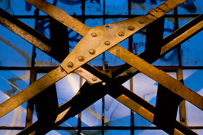 Structural beams in dilapidated warehouse windows in San Francisco.