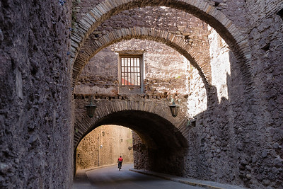 Cyclist under the archways of the stone tunnels in Guanajuato