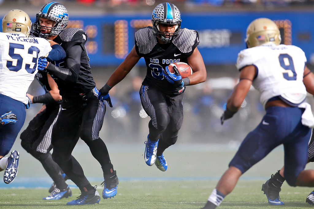 Air Force Falcons running back BROAM HART (32) moves into an opening in the first quarter. The Air Force Falcons hosted the Navy Midshipmen at Falcon Stadium in Colorado Springs, CO.