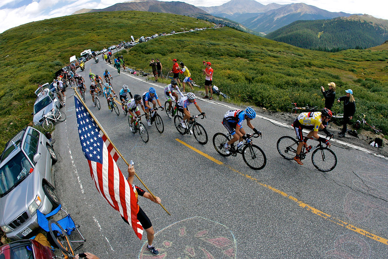 The peloton rides up Independence Pass trailing the lead rider by 3 minutes in the third stage of the USA Pro Cycling Challenge. The USA Pro Cycling Challenge runs from August 20-26.