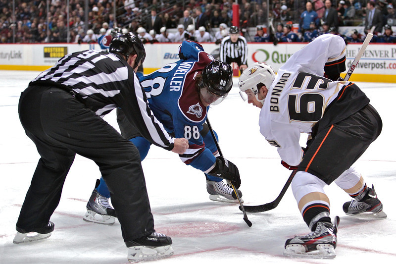 Colorado Avalanche right wing Peter Mueller (88) faces off against Anaheim Ducks center Nick Bonino (63) in the second period. After two periods of play the score is tied 1-1. The Colorado Avalanche hosted the Anaheim Ducks at the Pepsi Center in Denver, CO.