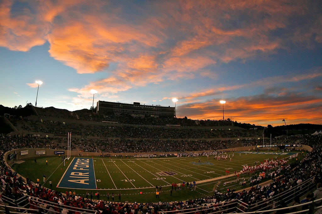A general view as the sun sets behind Falcon Stadium during halftime. The Air Force Falcons hosted the New Mexico Lobos at Falcon Stadium in Colorado Springs, CO.
