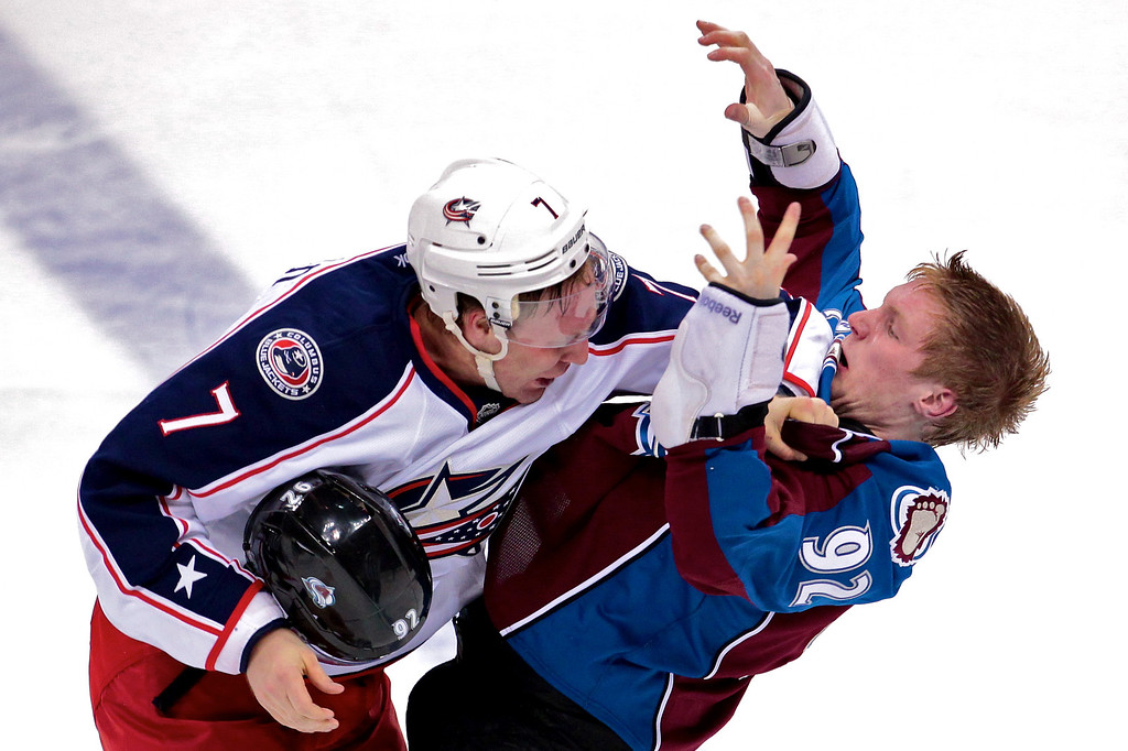 Colorado Avalanche left wing Gabriel Landeskog (92) loses his helmet and falls backwards after a fight in the second period with Columbus Blue Jackets defenseman Jack Johnson (7). After two periods of play Columbus leads 2-0. The Colorado Avalanche hosted the Columbus Blue Jackets at the Pepsi Center in Denver, CO.