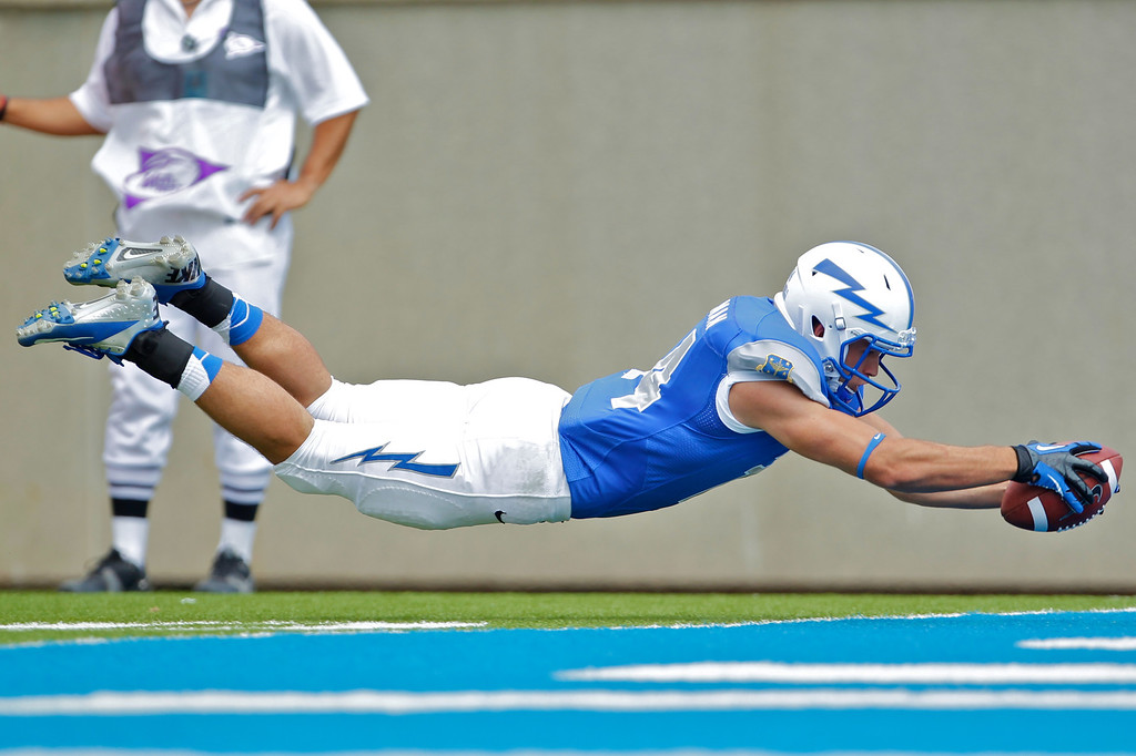 Air Force Academy Falcons wide receiver COLTON HUNTSMAN (14) dives for a touchdown in the second half. The United States Air Force Academy Falcons hosted the Idaho State Bengals at Falcon Stadium in Colorado Springs, CO.