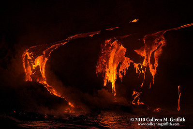 Fire And Brimstone ©  2010 Colleen M. Griffith. All Rights Reserved.  This material may not be published, broadcast, modified, or redistributed in any way without written agreement with the creator.  This image is registered with the US Copyright Office. www.colleenmgriffith.com www.facebook.com/colleen.griffith  It's was so amazing to get so close to liquid rock, flowing up from earth's core, and creating new land right before my eyes.  I just loved how the rock would cool on the surface, creating a skin, that would then break apart as it flowed into the sea.  I could even see it dripping onto the sandy shore and as the waves would come in, plumes of steam would rise as the ocean cooled and solidified the lava. About 10 feet of shoreline is captured in this shot.  Photo was taken August 23, 2010 in Volcanoes National Park, the Big Island of Hawaii.