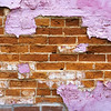Brick wall undernearth peeling purple paint, Wilmington, Illinois