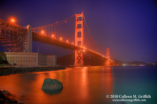 "The Golden Gate ©  2011 Colleen M. Griffith. All Rights Reserved. This material may not be published, broadcast, modified, or redistributed  without written agreement with the creator.  This image is registered with the US Copyright Office. Friend Colleen on Facebook  In this photo, I have removed some Green & White construction equipment (in the U.S., these are generally referred to as ""Cherry Pickers"") parked next to the building.  To see the original photo,  CLICK HERE  You can see more of my San Francisco photos, by going to my San Francisco gallery: www.colleenmgriffith.com/Galleries/California/San-Francisco"