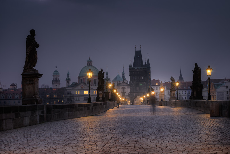 The Charles Bridge in Prague on an early morning before Sunrise. It would not be possible at all to shoot without or almost without people even at night.