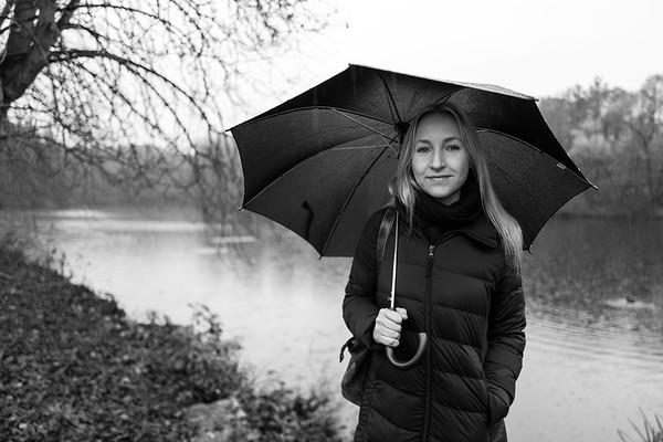 Blonde girl with umbrella in Kranichstein, Germany
