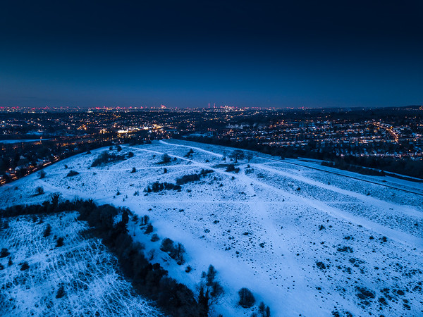 Snow on Farthing Downs looking to the lights of London
