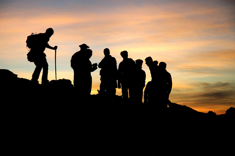 Sunset silhouette of group of hikers at Pacaya Volcano  Guatemala