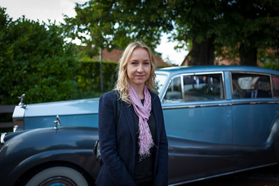 blonde girl in front of classic car