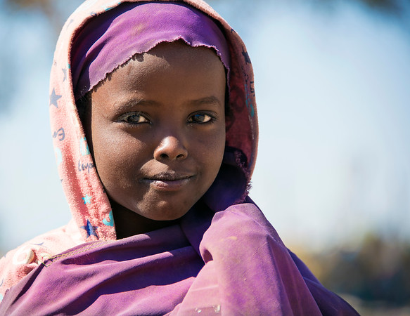 Young girl with a dusty face after playing in the dirt.
