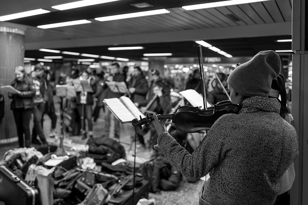 Frankfurt, Germany - December 09: Unidentified girl plays violin as part of a christmas concert in the Frankfurt Hauptwache underground on December 09, 2017 in Frankfurt, Germany.
