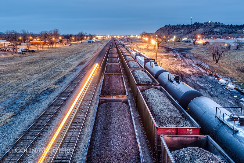 Trains moving coal through Forsyth, Montana.  Since the mines have been running, over 550 million tons of coal have been dug up. Enough earth has been moved to fill both the Erie and Panama canals five times over.  The proposed Tongue River Railroad would facilitate moving coal out of the Tongue River Valley and onward to the West Coast where it could be shipped to Asia.  See this link for important info about transporting coal by train:  http://www.coaltrainfacts.org/key-facts