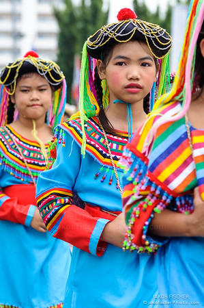 Traditionally dressed children in procession on Chiang Mai 37th Flower Festival parade