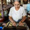 Burmese lady prepares Lotus threads