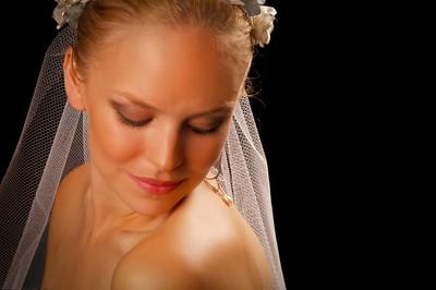 Eye Closed Bride Portrait on Dark Background
