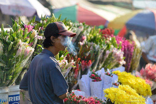 Burmese selling flowers on a market