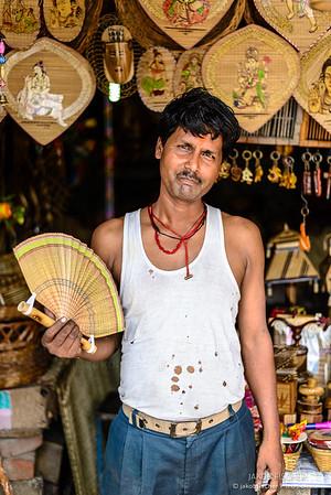 Indian with hand fan in Varanasi
