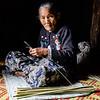 Burmese woman at work