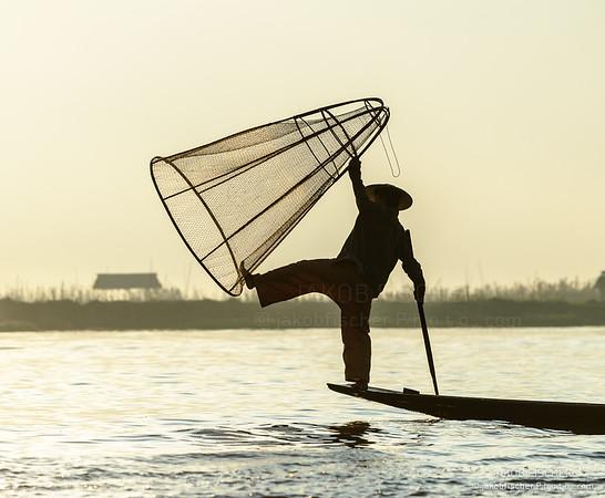 Leg rowing fisherman at Ine Lake