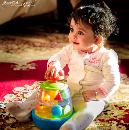 Pihu - Playing with musical toy ...