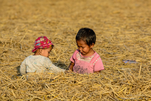 Burmese kids playing in the straw