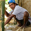 Indonesian constructing a bamboo hut