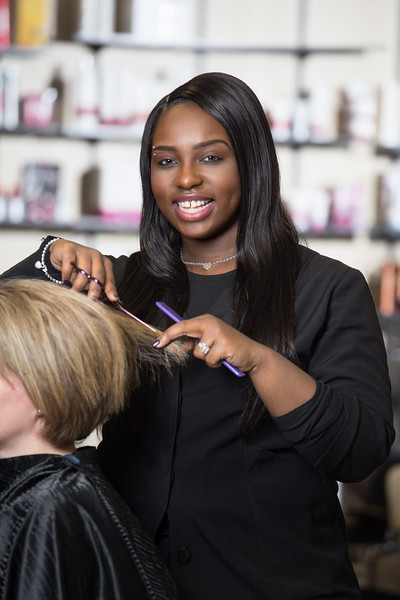 Salon Stylist cutting hair