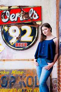 Senior photo by old signs