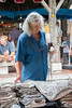Woman shopping for jeans. Villereal Market, SW France.