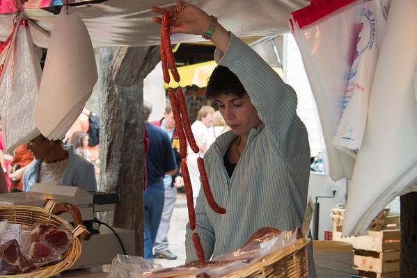 Woman selling 'Chorizos'. Villereal Market, SW France