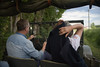 Couple driving through French countryside in Open-topped Jeep.