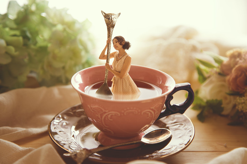 Woman in a tea cup.
