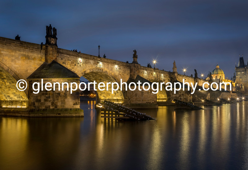 An evening shot of Charles Bridge, Prague.