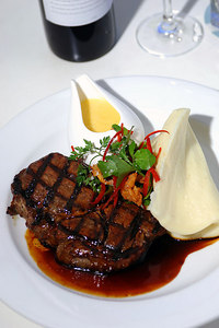 19 JUL 2006 TOWNSVILLE, QLD - Restaurant review at Watermark on Townsville's Strand.  Certified Angus Rib-Eye with creamy mash, horseradish hollandaise and red wine jus - PHOTO: CAMERON LAIRD