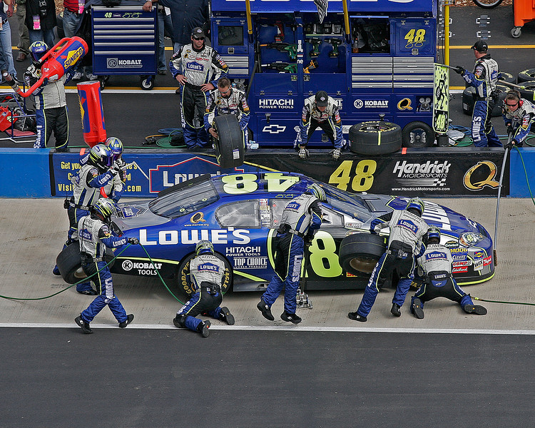 Jimmie Johnson's crew fast at work changing tires on the Lowe's #48 on pit road Talladega