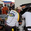 """Post crash, the Kevin Harvick, Inc., Hornaday Team works on Camping World Truck #33 after the """"Big One"""" at Talladega as NASCAR officials look on."""