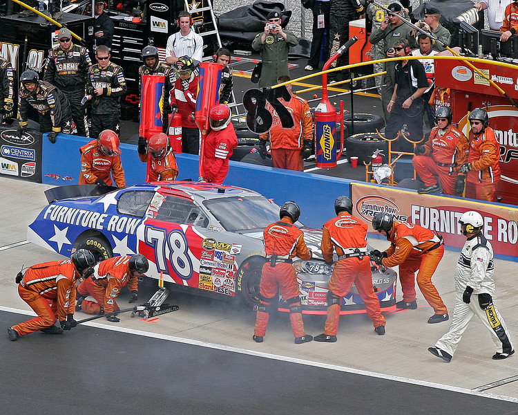 Everyone is curious as to what is smoking under the Furniture Row #78 car on Talladega's pit road