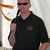 Jeff Burton speaking to fans in Cingular tent at Talladega before NASCAR event.