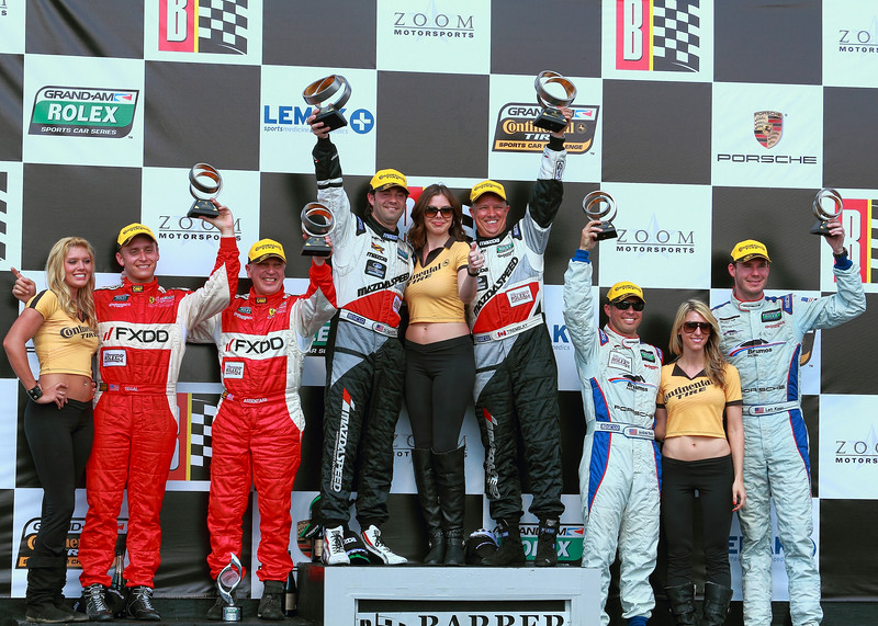 Continental Tire Girls on Podium with Barber Porsche 250 Grand-Am Rolex Sports Car GT Series Victors SpeedSource Drivers Bomarito and Tremblay