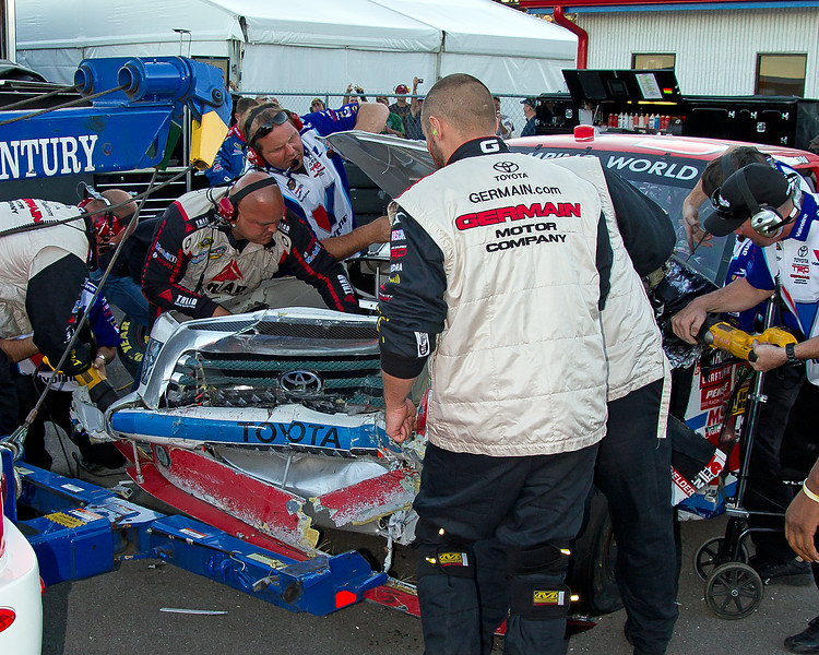 Bodine's Front End on his NASCAR Camping World Truck was Smashed as far back as it could go without destroying the engine.