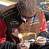 UPS pit crew member prepares lug nuts for race at Talladega
