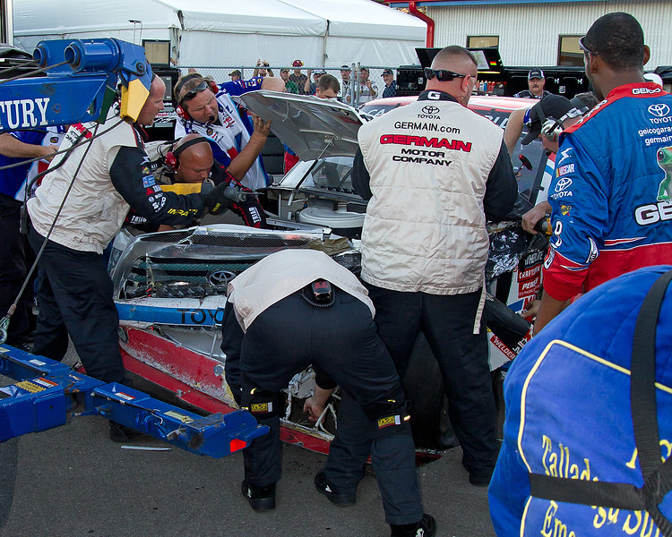Sheet Metal was Flying, Wrenches Turning, Torches Burning and People Pulling to get Bodine's Truck back into the race at The Mountain Dew 250 at Talladega