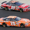 Carl Edwards Office Depot #99 and Tony Stewart Home Depot #20 make it a depot race off of Talladega pit road
