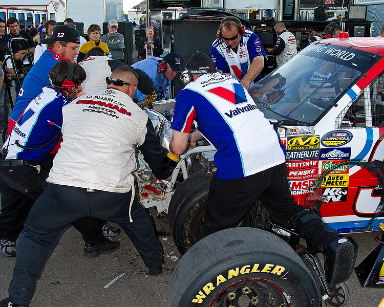 Bodine's Camping World Truck Team had to use every ounce of muscle power to pull the radiator and other parts of the front end away from the engine so Todd could get back out on the track at Talladega